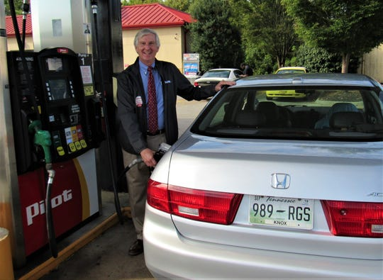 """""""Celebrity"""" gas pumper John Schoonmaker filled tanks at the Pilot in Farragut during the United Way fundraiser last year."""