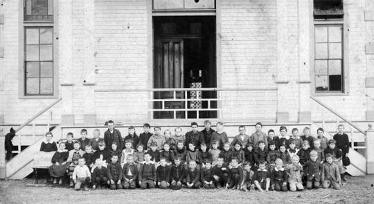 Students attending St. Landry High School in Opelousas during the early part of the 20th century.