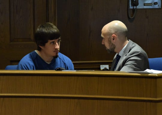 Marcus Van Wey, right, speaks with his client, Tyler Sunday, in the Fairfield County Common Pleas Court on Jan. 2. Sunday was sentenced to seven and a half years in prison.