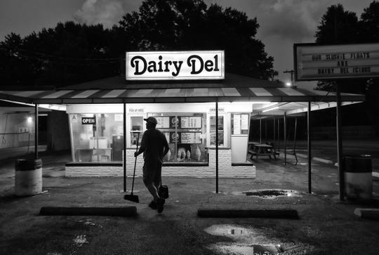 Dairy Del owner Kevin Lawhorn finished cleaning the parking lot before closing his ice cream shop for the night. The shop has been in business since 1951. June 21 , 2018.