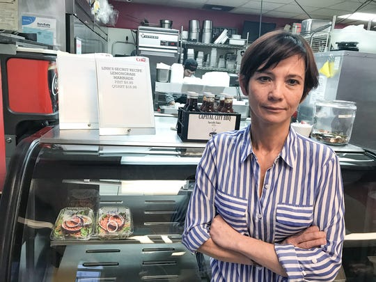 LInh Lee, owner of Capital City BBQ, says a bitter breakup is threatening her business. The restaurant's phone has a misleading recording that the eatery has closed until March 1.