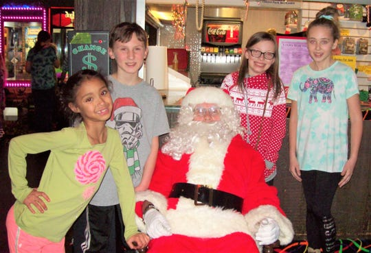 Pictured, from left, are winners of fourpair of skates from the recent Santa Skate event sponsored buy the Sunrise Optimist Club and Rollaire Skate Center: Na'riyah Edwards, Caleb Deicher, Mariah Musial and Shelby Anderson.