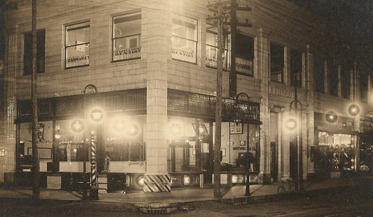 Manitowoc Gas Company office at North Eighthand Commercial streets, the Dempsey building circa 1920.