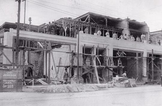 Construction workers of the M.H. Dempsey building at North Eighth and Maritime Drive in Manitowoc, circa 1910, stop to take a photo of their progress.