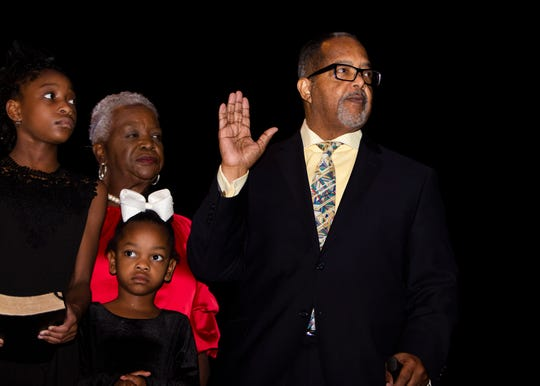 Myron Lowery, Memphis City Court Clerk, takes the oath of office as he is sworn in on January 1, 2020 at the Michael D. Rose Theatre Lecture Hall.