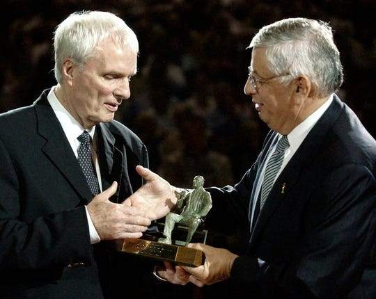 NBA commissioner David Stern, right, presents Memphis Grizzlies coach Hubie Brown with the NBA Coach of the Year award before the first-round playoff game between the Grizzlies and the San Antonio Spurs on Thursday, April 22, 2004, in Memphis, Tenn. (AP Photo/Mark Humphrey)