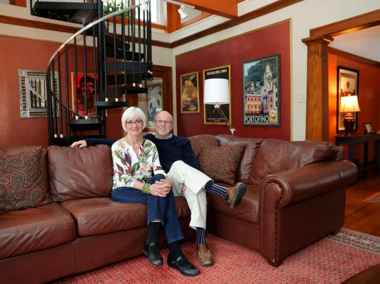 Steve Bell and his wife, Mary McGrath, sit in the living room of their home.