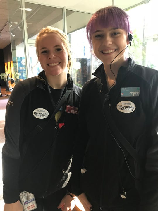 Milwaukee Public Museum visitor assistant team members, Rose Dentic and Alydia Stangle, welcome visitors to Milwaukee Museum Week 2018.