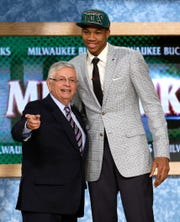 Former NBA Commissioner David Stern (left) stands with Giannis Antetokounmpo after being selected by the Milwaukee Bucks in the first round of the NBA draft in 2013.