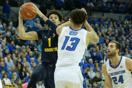 Marquette forward Brendan Bailey drives against Creighton forward Christian Bishop on Wednesday night.