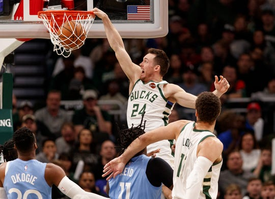 Bucks guard Pat Connaughton rises for a dunk in the fourth quarter Werdnesday night at Fiserv Forum