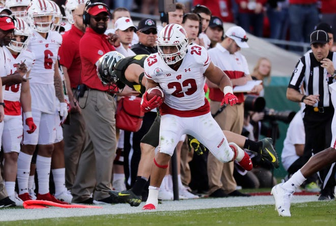 Badgers running back Jonathan Taylor is forced out of bounds in the second quarter.
