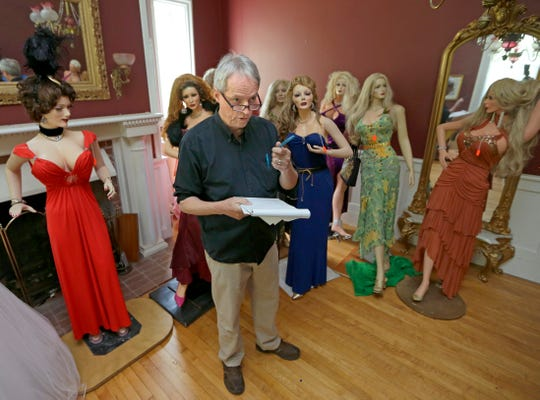 Milwaukee Journal Sentinel columnist Jim Stingl takes a count of some 60 glamorous mannequins created by the late Mike Martin before they were auctioned online by Beloit Auction & Realty September 1, 2016.