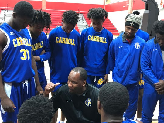 Carroll head coach Lonnie Cooper makes adjustments during a timeout. The Bulldogs beat Franklin Parish 53-46 on Thursday at Ouachita's Don Redden Memorial Classic.