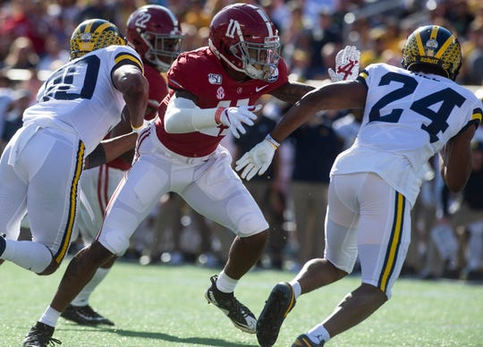 Alabama wide receiver Henry Ruggs, III, (11) blocks against Michigan in the Citrus Bowl in Orlando, Fla., on Wednesday January 1, 2020.