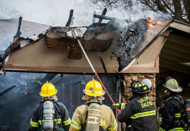 Firefighters battle a blaze in a home at 2104 N. Westbrook Dr. in Yorktown Thursday. According to investigators, the fire began in the garage at around 2 p.m. and spread into the home's attic. Two occupants of the home were able to escape uninjured. First responders were on scene within eight minutes of the fire being dispatched and had the fire contained within 20 minutes.The cause of the fire is still under investigation.