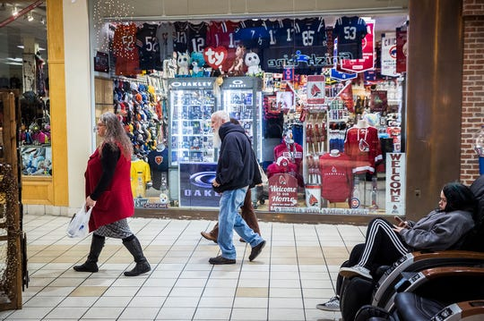 Customers visit the Muncie Mall.