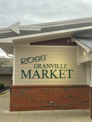 A new sign points the way to the online pick-up site outside Ross' Granville Market.