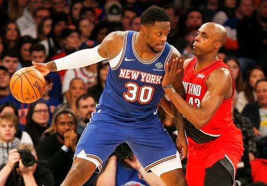 Jan 1, 2020; New York, New York, USA; New York Knicks forward Julius Randle (30) dribbles the ball against Portland Trail Blazers forward Anthony Tolliver (43) during the first half at Madison Square Garden.