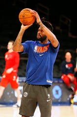 New York Knicks guard Reggie Bullock (25) shoots during warmups prior to the game against the Washington Wizards at Madison Square Garden.