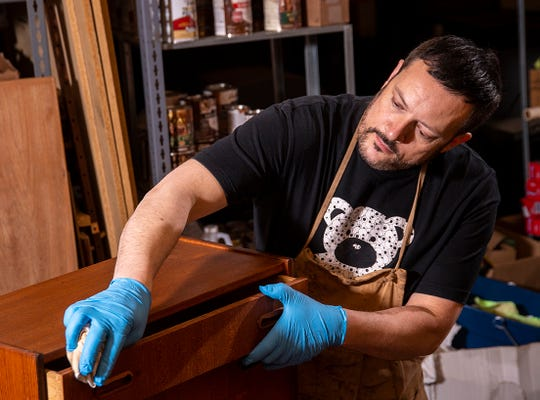 Each piece of vintage Danish Midcentury furniture imported by Lanoba is carefully refurbished by Lars Noah Balderskilde, above, and David Singh before being placed on the showroom floor for resale.