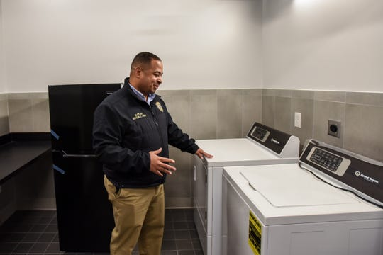 An old firehouse has recently been renovated into a resource center for homeless individuals. Passaic Mayor Hector C. Lora shows the laundry room in Dignity House in Passaic on Thursday January 2, 2020.