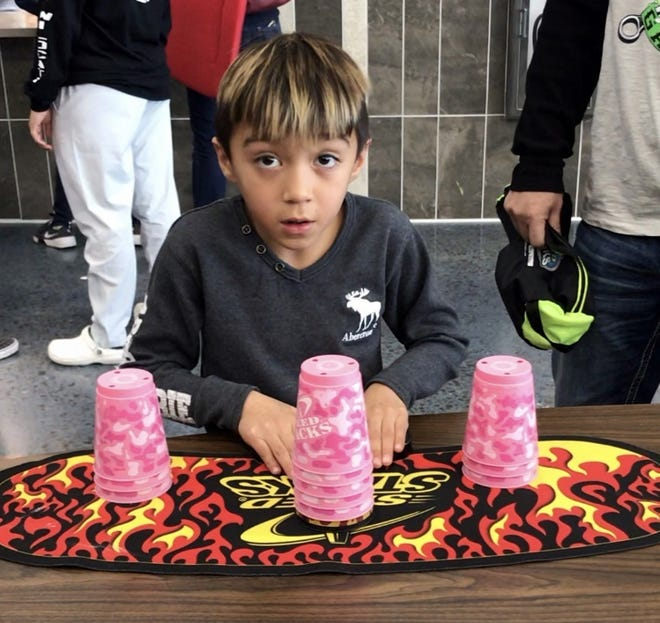 Lencho Anaya, 7, a Bayard, NM native, is cultivating his skills as a competitive cup stacker. The Bayard Elementary School student hopes to one day meet his favorite professional stacker Hyeon Jong Choi in Korea.