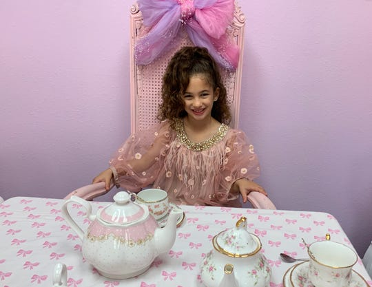 Dior Halum is photographed on Dec. 22 at Amanda's, A Shabby Chic Tea Room & Boutique.