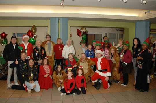 Hospital staff and Santa Stroll supporters commemorate the 2019 Santa Stroll.