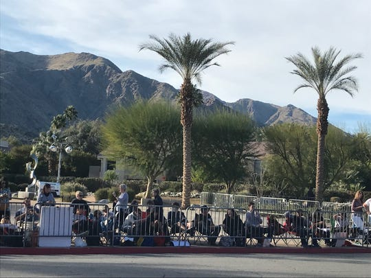 Fans sit across the street from the Palm Springs Convention Center, where celebrities will walk the red carpet ahead of the Palm Springs International Film Festival's Film Awards Gala, Jan. 2, 2020.