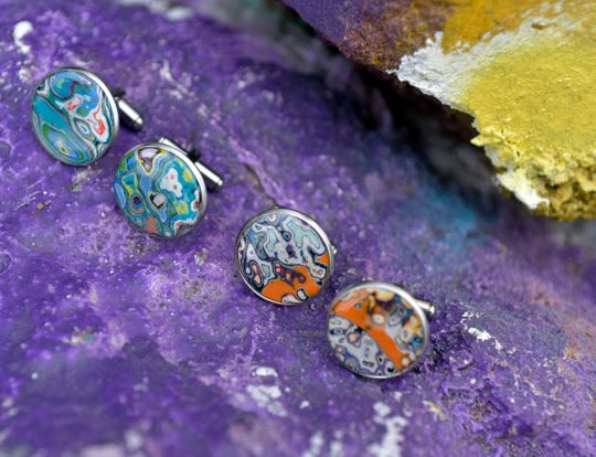 Jewelry created by Joseph Seurkamp from paint off the Graffiti Bridge is pictured Thursday. Seurkamp, who also maintains the Graffiti Bridge Facebook page, secured the trademark rights for the Graffiti Bridge.