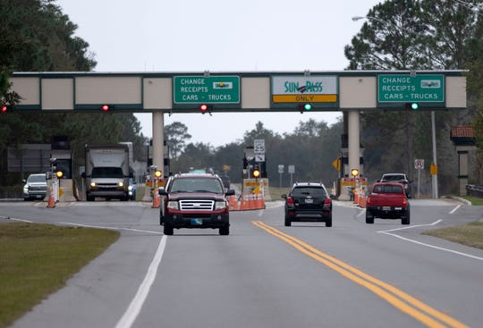 Drivers travel across the Garcon Point Bridge on Jan. 2. A judge is forcing FDOT to raise tolls on the bridge from $3.75 to $5.