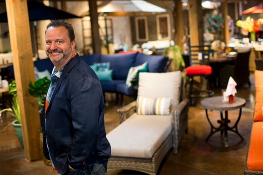 Tony Schindler stands in his store  Paddy O Furniture in Scottsdale, Arizona on Dec. 12, 2019.