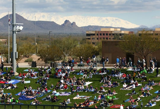 The snow-capped Four Peaks mountain range is seen over right field as the Arizona Diamondbacks play the Colorado Rockies during a spring-training game at Salt River Fields in Scottsdale.