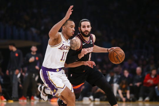 Phoenix Suns' Ricky Rubio (11) drives against Los Angeles Lakers' Avery Bradley (11) during the first half of an NBA basketball game, Wednesday, Jan. 1, 2020, in Los Angeles. (AP Photo/Ringo H.W. Chiu)