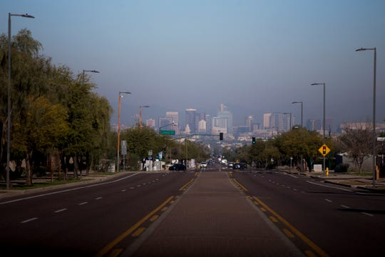Air pollution is seen over a hazy downtown Phoenix on Jan. 2, 2020.