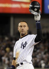 New York Yankees' Derek Jeter tips his cap after hitting a single during the seventh inning of a baseball game against the Tampa Bay Rays on Wednesday, Sept. 9, 2009, at Yankee Stadium in New York. The hit tied Jeter with Lou Gehrig for most hits by a Yankee. (AP Photo/Bill Kostroun)