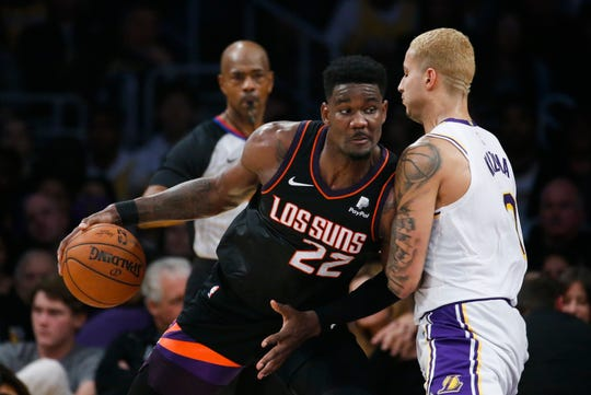 Phoenix Suns' Deandre Ayton (22) drives against Los Angeles Lakers' Kyle Kuzma (0) during the second half of an NBA basketball game, Wednesday, Jan. 1, 2020, in Los Angeles. The Lakers won 117-107. (AP Photo/Ringo H.W. Chiu)