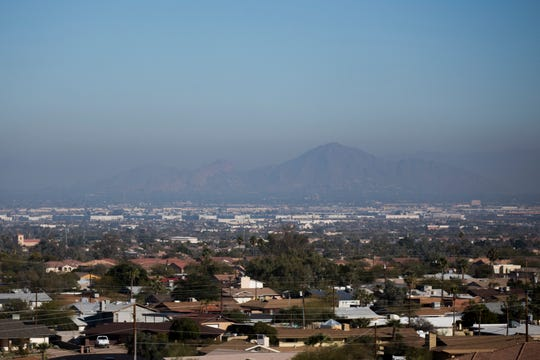 Air pollution is seen over a hazy Camelback Mountain on Jan. 2, 2020, in Phoenix, Ariz.