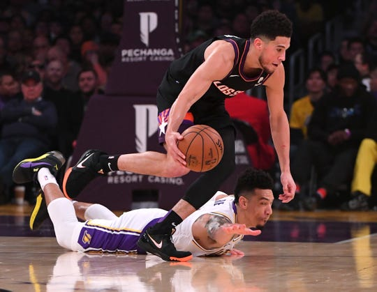 Jan 1, 2020; Los Angeles, California, USA;  Phoenix Suns guard Devin Booker (1) and Los Angeles Lakers guard Danny Green (14) dive for a loose ball in the first quarter of the game at Staples Center. Mandatory Credit: Jayne Kamin-Oncea-USA TODAY Sports