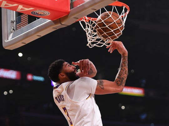 Jan 1, 2020; Los Angeles, California, USA;  Los Angeles Lakers forward Anthony Davis (3) goes up for a dunk in the first half of the game against the Phoenix Suns at Staples Center. Mandatory Credit: Jayne Kamin-Oncea-USA TODAY Sports