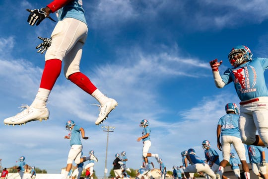 The South Mountain High School football team gets ready to play against North Canyon High School on Aug. 30, 2019.