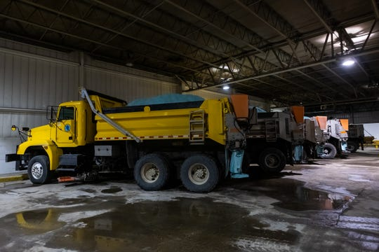 Salt trucks are seen parked at the St. Clair County Road Commission Thursday, Jan. 2, 2020. St. Clair County Road Commission said the lack of snow has had a positive impact as they have had to use less resources, like road salt and plow trucks.