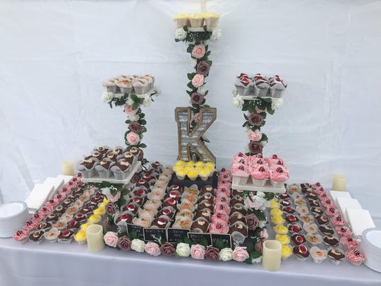 A wedding cupcake display created by Marlena Phillips, one of the founder's of Steaks and Cupcakes LLC in Sanilac County.