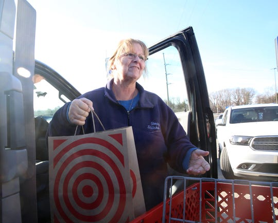 Linda Anderson of the Town of Poughkeepsie unloads a paper shopping bag from Target on January 2, 2020.  Dutchess County's plastic shopping bag ban began in on January 1st.