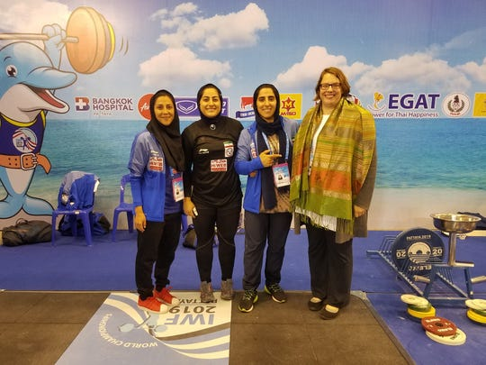 Sally Van de Water on the far right pictured with members of the Women's National Team of Iran, at the 2019 Weightlifting World Championships in Pattaya, Thailand.