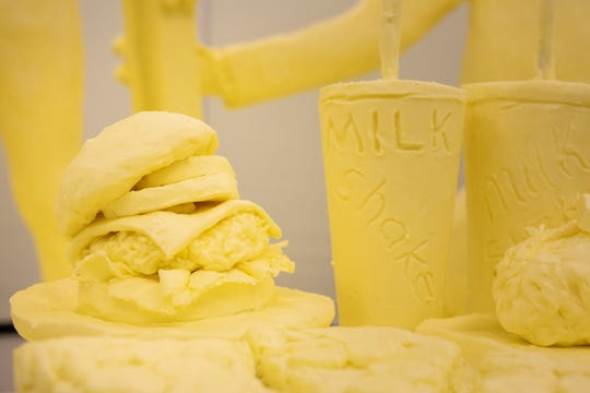 A detail of a burger and milk shakes as part of the 2020 butter sculpture at the Pennsylvania Farm Show.