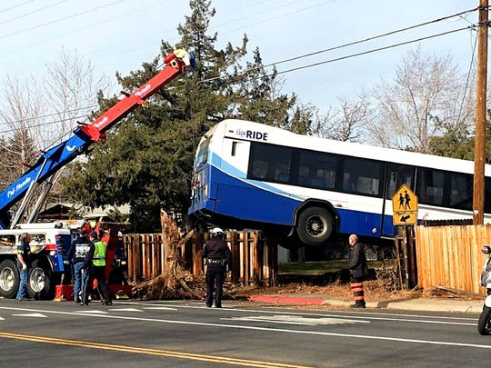 A submitted photos showing a bus being towed from the scene of a crash on Thursday, Jan. 2, 2020. The driver, who suffered from a medical condition, rammed the bus through a fence and into a nearby yard on West Seventh Street and Heights Drive in west Reno.