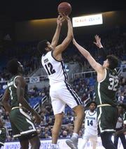 Nevada's Johncarlos Reyes shoots while taking on Colorado State during their basketball game at Lawlor Events Center in Reno on Jan. 1, 2020.