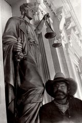 Greg Melton and the Lady of Justice statue.